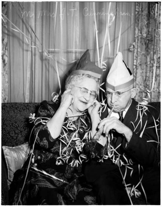 Funny Awkward Family Photos: Vintage snap of old couple celebrating New Years, 1950s