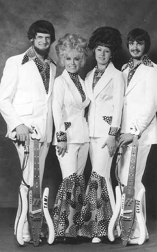 vintage old promo pic of 1970s country band Tami & Clyde, big hair white flashy suits
