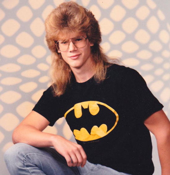 1980s High School piyearbok picture: Dude with big hair, mullet in Batman shirt