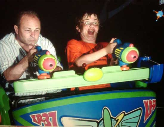 funny awkward family photos: dad and son on amusement park ride
