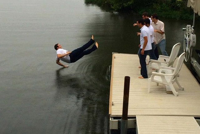 perfectly timed photos ~ man failing in lake
