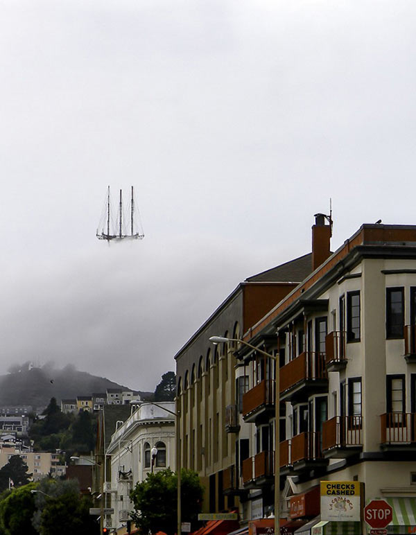 perfectly timed photos ~ ship floating in clouds