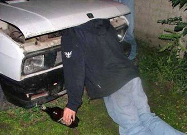 Funny Pics~ man passed out with head stuck under hood of car