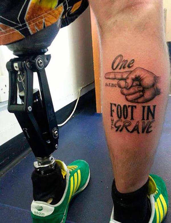 33 Funny Pics~ leg tattoo on veteran missing leg, one foot in the grave