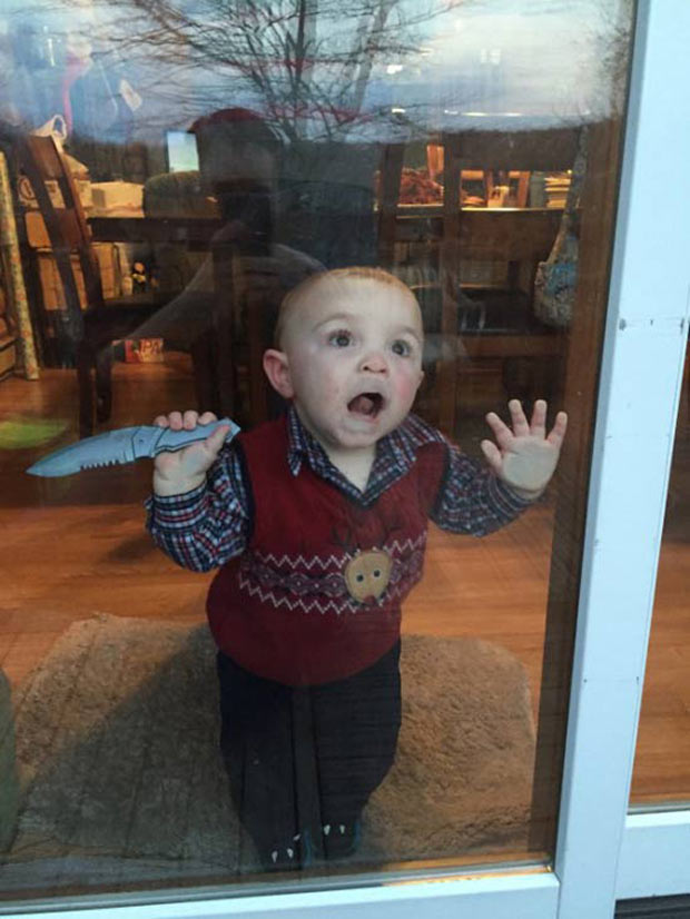Funny Pics & Memes ~ baby face pressed up against sliding door holding knife