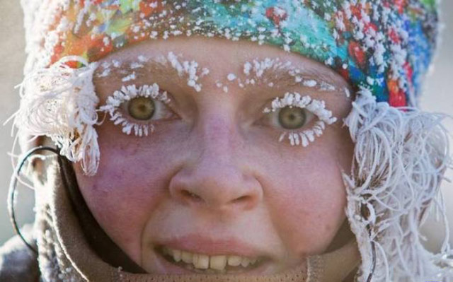 Cool pic of woman with in snow with frosted frozen eyelashes and hair