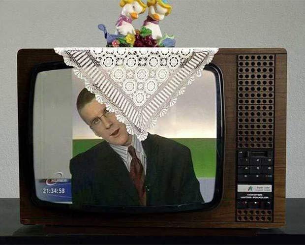 35 Funny Pics ~ Man on TV peeking around laced doily
