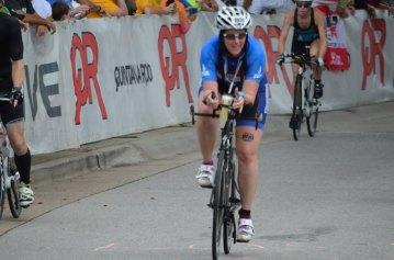 Amanda racing on her bike in 2015