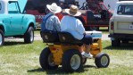 photo of two riders on a lawn mower