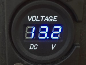 photo of volt meter showing 13.2 volts