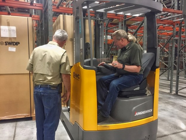 photo of Bob and Jim with forklift
