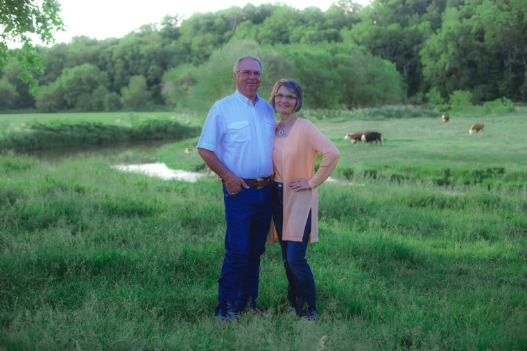 Photo of Larry & Pam Teasdale standing in a pasture.