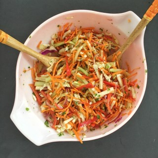 This refreshing slaw features jicama, carrots, cabbage, cucumbers and bell peppers - a perfect side dish for almost any meal. Recipe at Teaspoonofspice.com