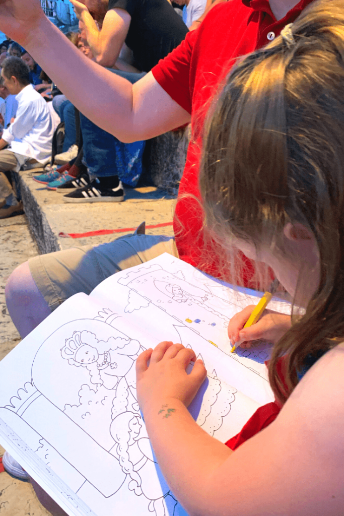 Distracting with colouring in while waiting for the opera to start in the Verona Arena