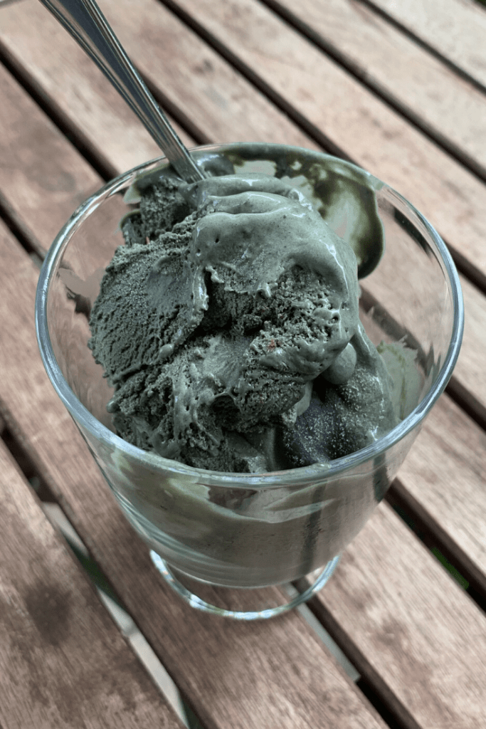 Ice ice, Baby! Our black liquorice ice cream; black licorice ice cream; for liquorice lovers and likers alike. With glass with two scoops of black liquorice ice cream and a spoon