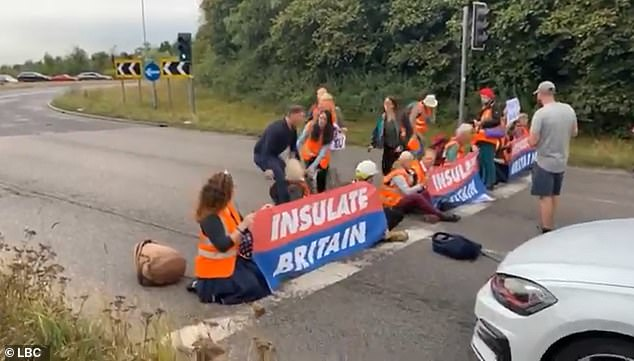 Motorists clash with Insulate Britain climate activists ...