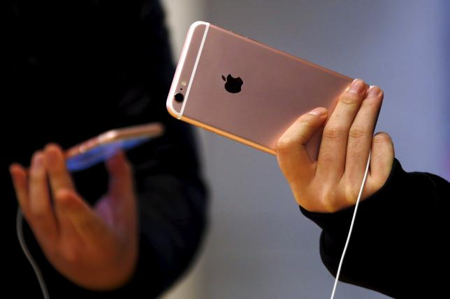 Customers hold the iPhone 6s during the official launch at the Apple store in central Sydney, Australia
