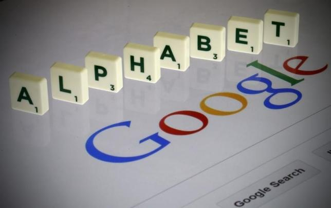 "Letters spell the word ""Alphabet"" as they are seen on a computer screen with a Google search page in this photo illustration taken in Paris"