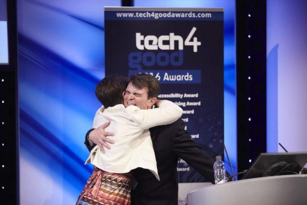 Liz Williams hugging Robin Christopherson as he receives the Tech4Good Special Award