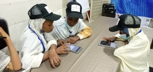 4 young girls using the Maker App to create storybooks in Nigeria