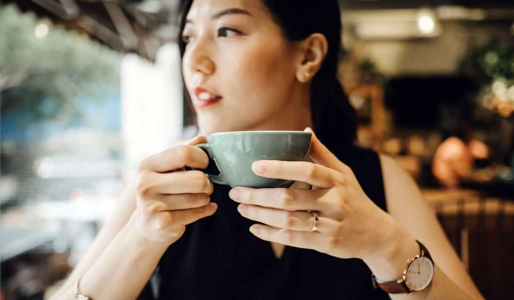 Chinese girl drinking coffee