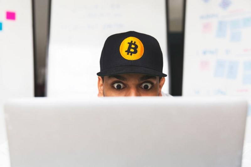 1 shocked bitcoin investor on laptop