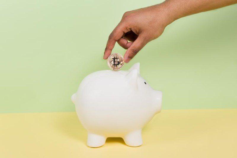 24 putting bitcoin into piggy bank