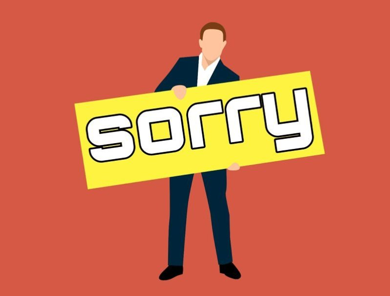 Man Cartoon Character with Sorry Board