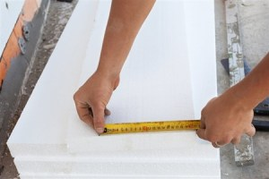 Long Island Home Inspection a man measuring