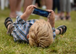 child looking up at the phone