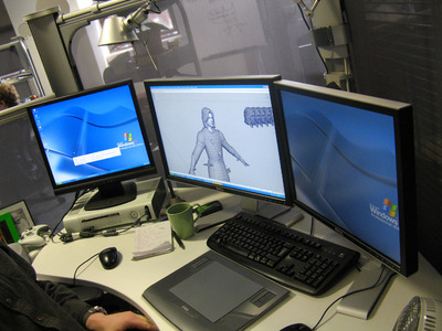 man-with-three-pc-monitors.jpg