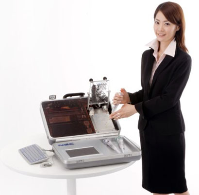 nec-portable-dna-tester-and-lady.jpg