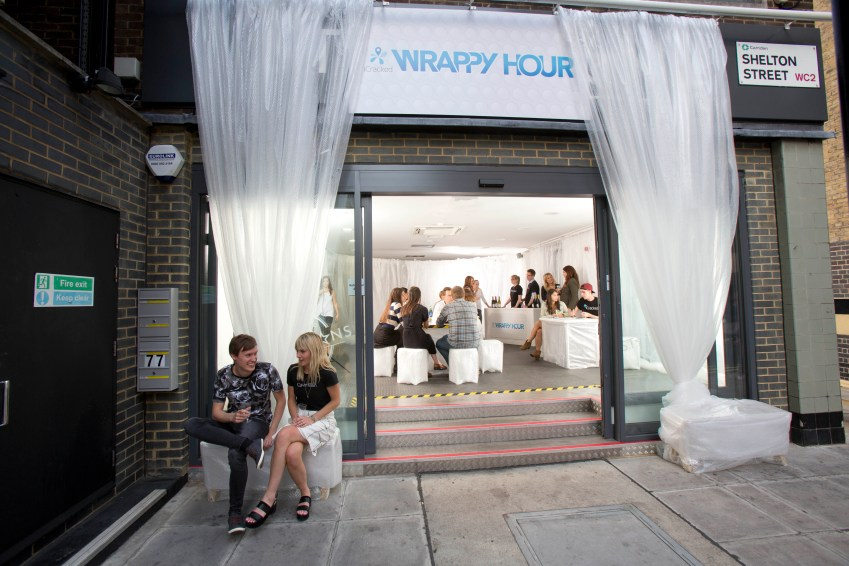 Wrappy hour: Londoners enjoy drinks at iCracked's bubble-wrapped 'world's safest bar' in Covent Garden where it's impossible to break your phone.