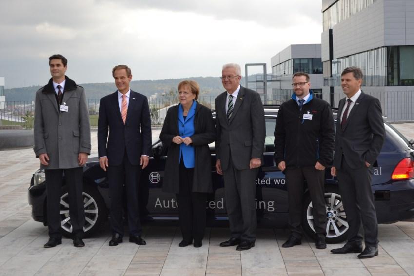 German Chancellor Angela Merkel in front of Bosch's self-driving car