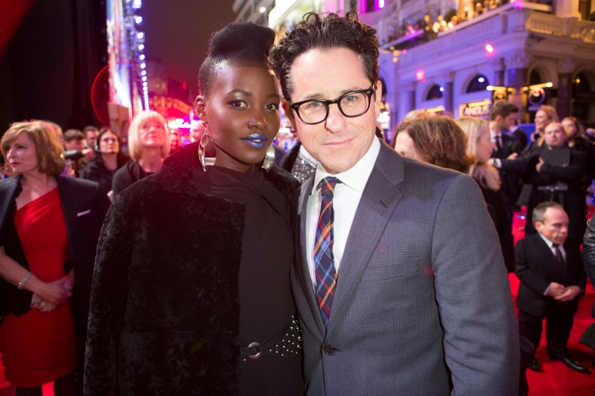 LONDON, UK - DECEMBER 16: Director JJ Abrams and actress Lupita Nyong'o attend the European Premiere of the highly anticipated Star Wars: The Force Awakens in London on December 16, 2015. Credit James Gillham / StingMedia