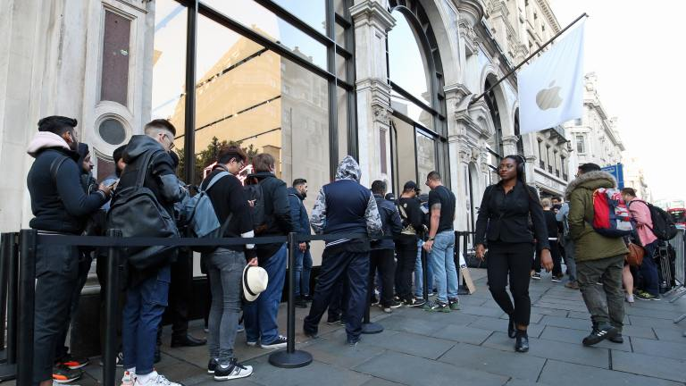 Apple fans queue overnight for iPhone 11