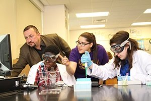 Jan Halámek (left) and UAlbany Ph.D. student Juliana Agudelo (one from right) are working with Averill Park high school students on both discoveries. (Photo by Gregory Panzanaro)