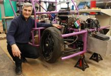 Prof. Amir Khajepour stands next to a vehicle containing his new wheel unit. CREDIT University of Waterloo