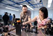 Pictured here (from left) are Senior Research Fellow James Grieve of the Centre for Quantum Technologies at NUS and Dr. Amelia Tan, Senior R&D Researcher of Trustwave, Singtel's cyber security subsidiary. (Credit: National University of Singapore)