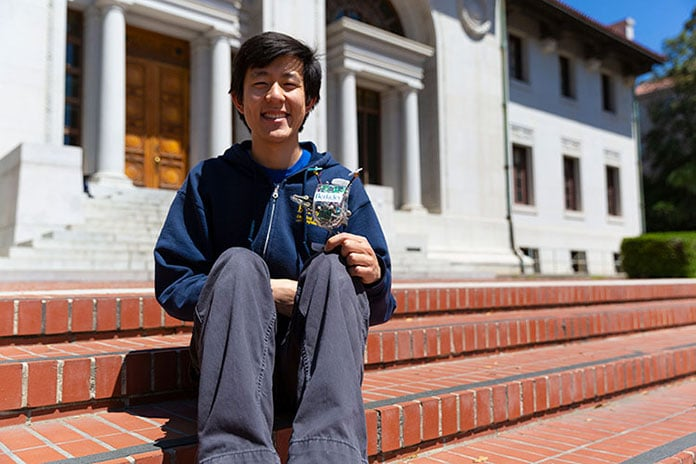 Robotics graduate student Justin Yim led the effort to program Salto with sophisticated control software that lets the robot master complex maneuvers. (UC Berkeley photo by Stephen McNally)
