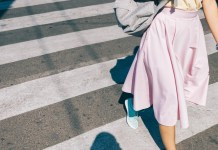 Women wearing pink skirt, walking on street with blue shoes