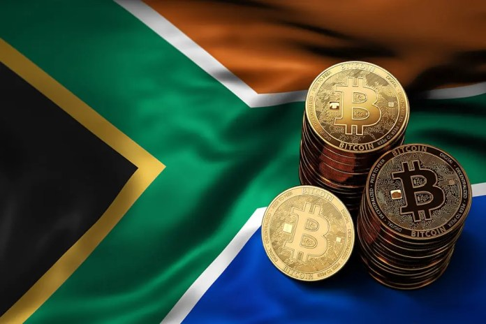 Stack of Bitcoin coins on Southern Africa flag.