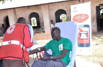 A Hind's feet volunteer donates blood at the air tel community health fair in Arua