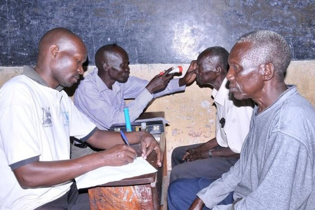 Opticians attend to some of the people that truned up for  the Airtel community health fair in Arua district