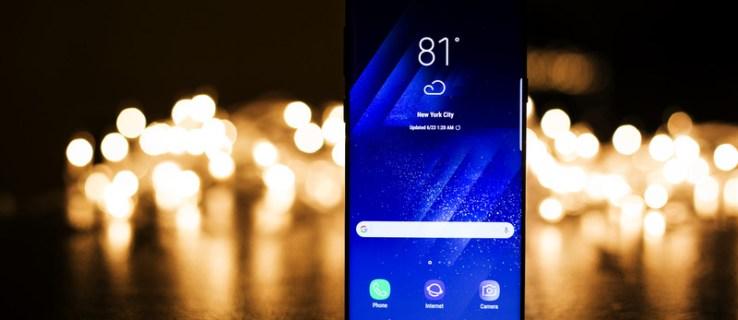 Canva Turned on Midnight Black Samsung Galaxy S8 Near Bokeh Lights