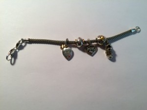 The commemorative charm bracelet from my parents
