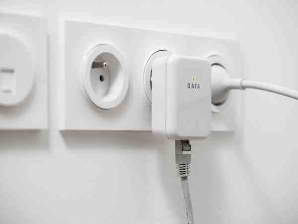 Powerline network adaper plugged into a wall socket