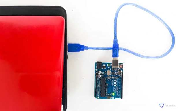 An Arduino Uno powered up using a USB cable