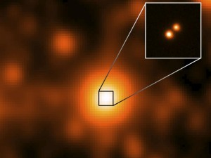 WISE J104915.57-531906 is at the center of the larger image, which was taken by the NASA's Wide-field Infrared Survey Explorer (WISE). Image credit: NASA/JPL/Gemini Observatory/AURA/NSF