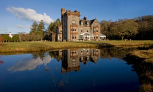Reflected glory: the hotel is set in stunning grounds, and has its own pier on the lochside